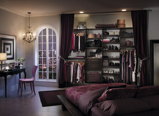 Sophisticated master bedroom closet flanked by draperies